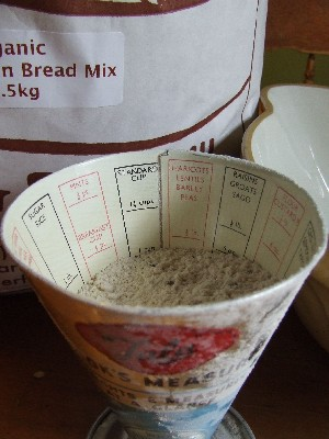 Measuring out Demeter flour for pizza muffins in the Tala Cook's Measure